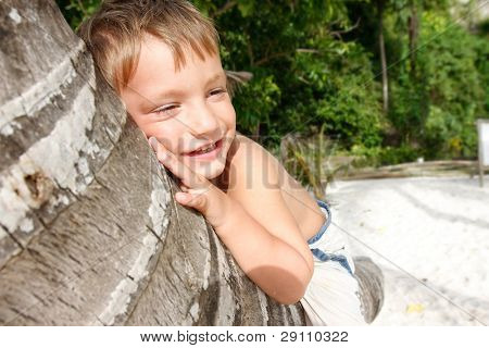 young smiling boy on tropical beach