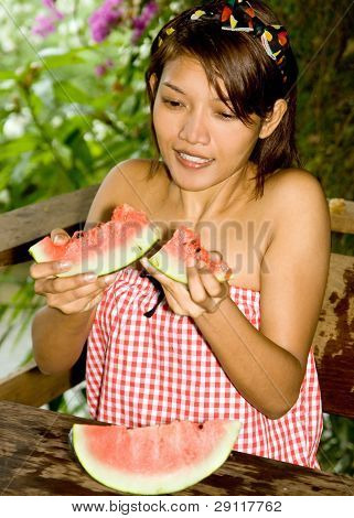 woman eating a water melon