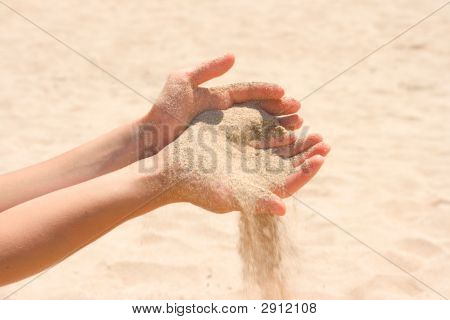 Sand Running Through Hands