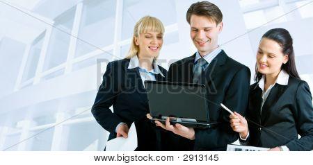 Three People Working