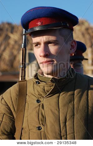 KIEV,UKRAINE - NOV 9: Person in Soviet WW2 military uniform of NKVD (KGB) Member of military history club Red Star. Historical military reenacting Kiev ,Ukraine. 7-9 November 2008