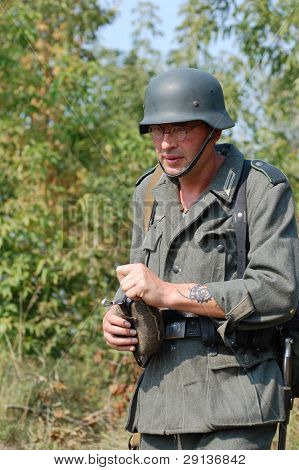 KIEV, UKRAINE - SEPTEMBER 6, 2008: Member of military history club Red Star. Person in German WW2 military uniform. Historical military reenacting in Kiev, Ukraine, September 6, 2008.