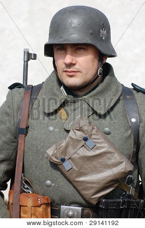VINNITSA, UKRAINE - MAR 21: A member of a history club called Red Star wears a historical German uniform as he participates in a WWII reenactment in Vinnitsa, Ukraine March 21, 2009.