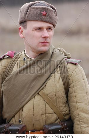Person in historical Soviet uniform as he participates in a WWII reenactment in Vinnitsa, Ukraine on March 21, 2009.
