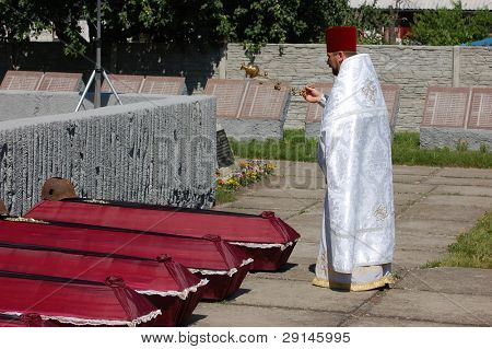 KIEV,UKRAINE- JUNE 21:  Priest. Lost soldiers of WW2 funerals. June 21,2008. Kiev,Ukraine