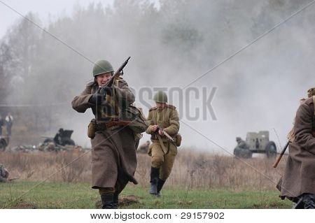 KIEV, UKRAINE - DEC 6: Members of a history club wears historical Soviet uniforms during a WWII reenactment 'Defense Kiev' in 1943 on December 6, 2009 in Kiev, Ukraine.