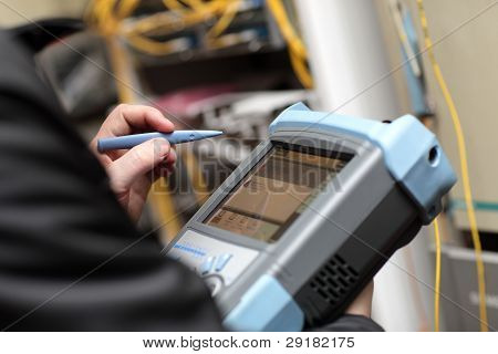 Technician Holding Reflectometer
