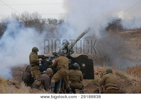 KIEV, UKRAINE - NOV 7: A members of military history club wears historical Soviet uniform& air defense cannon during historical reenactment of WWII,November 7, 2010 in Kiev, Ukraine