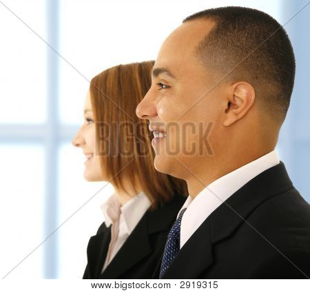 Business Man And Business Woman Smiling