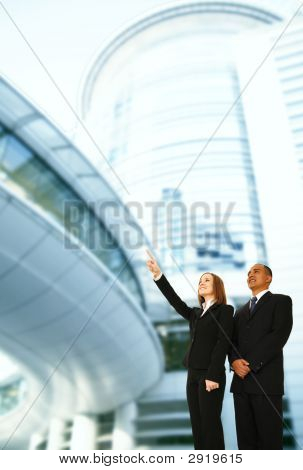 Business Team Pointing With Building Background