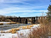 Walking Along A Pathway Beside The Sturgeon River In St. Albert, Alberta, Canada.  The Snow And Ice  poster