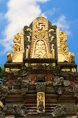 stock photo of swastika  - Roof of the Hindu temple with swastika in front - JPG