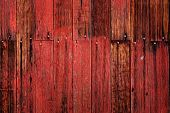 Old red barn in field late fall or autumn brown grass weathered wood poster
