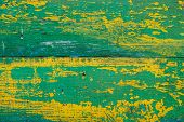 Old Wooden Painted Rustic Wall With Yellow Green Flaky Dye. Faded Wood Plank Close-up. Peeling Paint poster