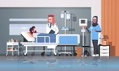 Arab Doctor And Nurse In Hijab Visiting Patient Man Lying Bed With Dropper Intensive Therapy Ward He poster