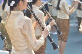 Young Girl Wear Thai Traditional Suit Playing Clarinet For Show In Marching Band Paraded On Street W poster