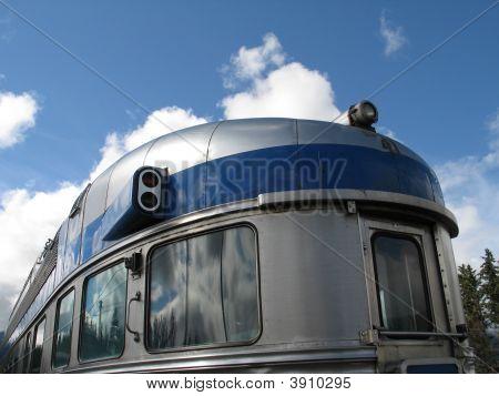 A Large Silver Passenger Train Close Up
