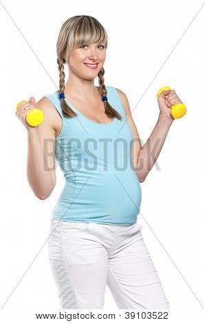 Pregnant woman in a fitness workout using hand weights isolated on white background