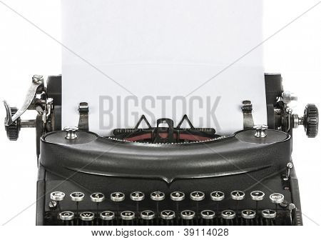Vintage portable typewriter with paper on white.