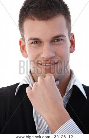 Portrait of casual young businessman smiling.