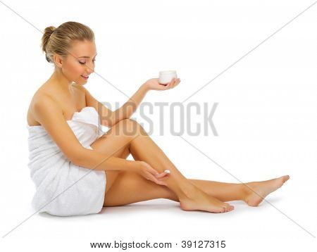 Young smiling girl with body cream isolated