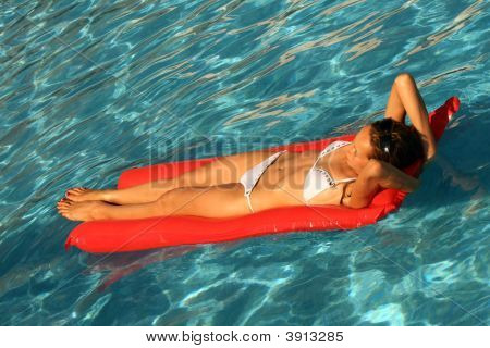 Woman Swimming An Air Matress