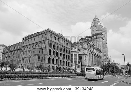 Shanghai Waitan district with historic buildings and street in black and white