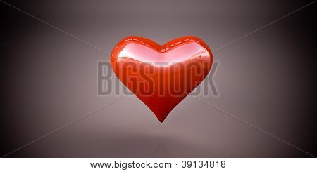 Shiny red heart on a dark gray background, vignetting
