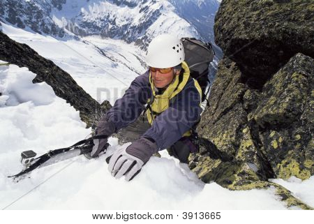 Man Mountain Climbing In Snow