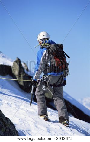 Men Mountain Climbing In Snow
