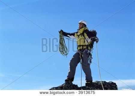 Men Mountain Climbing In Snow, Reaching The Top