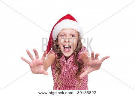 jovial girl in santa claus hat over white background