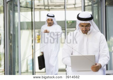 Middle Eastern Business With Man On Laptop