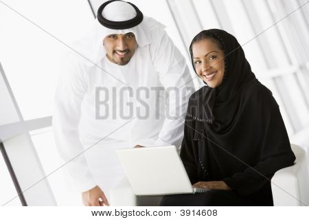 Middle Eastern Business Man / Woman Using Laptop