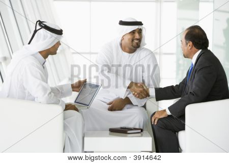 Middle Eastern Men Discussing Business