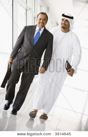 Middle Eastern Business Men Walking Down Corridor