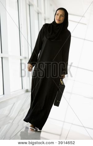 Middle Eastern Business Woman Walking Down Corridor