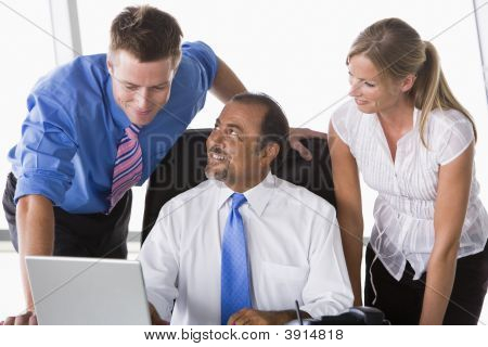 Middle Eastern Business People At Desk Using Laptop
