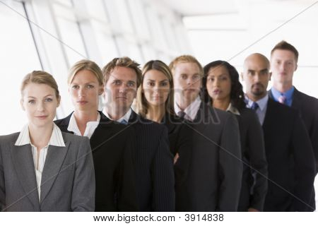 Middle Eastern / Western Business People Stood In Line