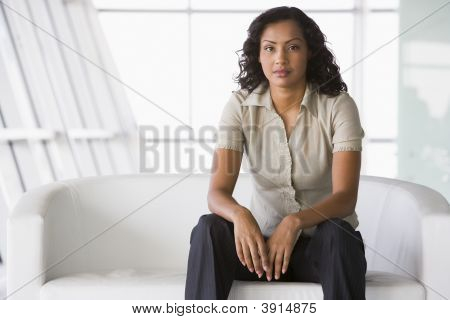 Middle Eastern Business Woman On Sofa
