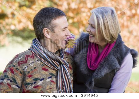 Couple Sat On Woodland Fence