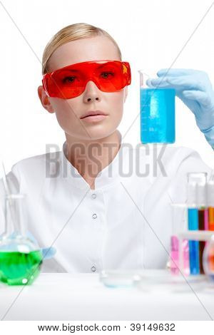 Doctor in spectacles does some experiments, isolated on white