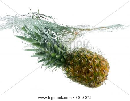 Pineapple Falling In Water With Bubbles
