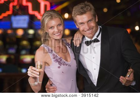 Man And Woman Outside Casino With Champagne In Hand