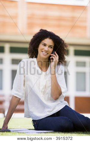 Woman Sat Outside School On Cell Phone