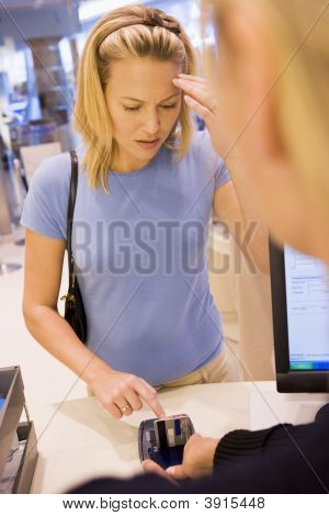 Woman Trying To Remember Pin Number In Shop