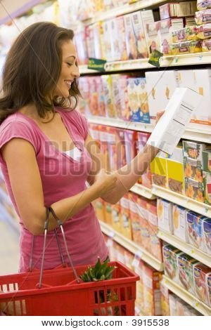 Woman Reading Packet In Supermarket