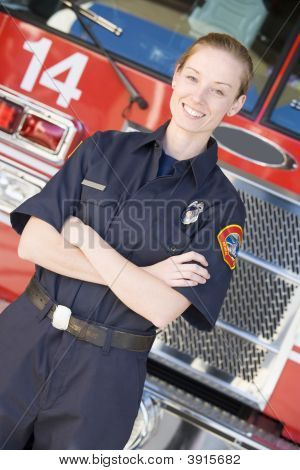 Firefighter Standing By Engine