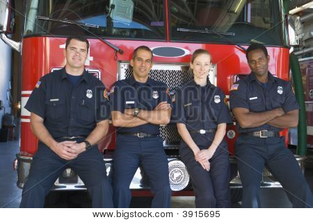 Firefighters Standing By Engine