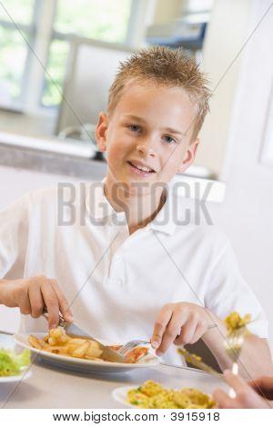 Pupil Eating School Dinner